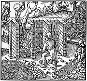 Roasting copper in a furnace; C. A: cakes of smelted copper, B: wooden faggots for heat. On right man is using wooden wheelbarrow. From Agricola (George Bauer) 'De re metallica', Basle, 1556