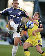 Cardiff City's Gabor Gyepes holds off the challenge from Preston's Neil Mellor. Coca Cola championship, Cardiff city v Preston NE at Ninian Park on Sat 6th Dec 2008. pic by Andrew Orchard,Andrew Orchard sports photography