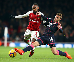 November 29, 2017 - London, England, United Kingdom - Arsenal's Alexandre Lacazette gets tackled by Huddersfield Town's Martin Cranie..during Premier League match between Arsenal and Huddersfield Town at Emirates Stadium, London,  England on 29 Nov   2017. (Credit Image: © Kieran Galvin/NurPhoto via ZUMA Press)