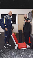 """Dwayne Johnson releases a photo on Instagram with the following caption: """"Meet the mastermind behind my fitness regimen, @DaveRienzi. Our approach to my business, training \u0026 wellness requires Dave\u2019s approach to be EXTREMELY detailed with laser sharp focus and application. It\u2019s a constant management of my body, recovery, wellness balance \u0026 mental nuance \u0026 anchoring. And then I destroy the hell outta my cheat meals \ud83d\ude08\ud83d\udcaa\ud83c\udffe\n#BendBoundariesCollection #ProjectRock #DwayneJohnsonTraining \n#RienziStrength"""". Photo Credit: Instagram *** No USA Distribution *** For Editorial Use Only *** Not to be Published in Books or Photo Books ***  Please note: Fees charged by the agency are for the agency's services only, and do not, nor are they intended to, convey to the user any ownership of Copyright or License in the material. The agency does not claim any ownership including but not limited to Copyright or License in the attached material. By publishing this material you expressly agree to indemnify and to hold the agency and its directors, shareholders and employees harmless from any loss, claims, damages, demands, expenses (including legal fees), or any causes of action or allegation against the agency arising out of or connected in any way with publication of the material."""