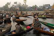 Vendors congregate at Srinagar's floating market,where the canals that feed into Dal Lake meet. It begins before sunrise and disbands once the majority of deals have been done. Vegetables and flowers are heaped onto wooden canoes as the vendors jostle for position in the heart of the market.