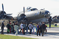 Montgomery, N.Y. - A B-17 Flying Fortress draws a crowd at Orange County Airport in Montgomery on Sept. 29, 2006. The World War II bomber was at the airport as part of the Wings of Freedom Tour.