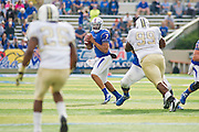 Dec 1, 2012; Tulsa, Ok, USA; University of Central Florida Knights defensive back Clayton Geathers (26) and defensive lneman Jose Jose (99) looks on as Tulsa Hurricanes quarterback Cody Green (7) looks to pass during a game at Skelly Field at H.A. Chapman Stadium. Tulsa defeated UCF 33-27 in overtime to win the CUSA Championship. Mandatory Credit: Beth Hall-USA TODAY Sports