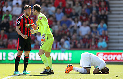 Swansea City's Jordan Ayew (right) rues a missed chance whilst AFC Bournemouth goalkeeper Asmir Begovic and Simon Francis (left) clash during the Premier League match at the Vitality Stadium, Bournemouth.