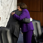 Sen. Dianne Feinstein (D-Calif.) hugs Senate Judiciary Committee Chairman Lindsey Graham (R-S.C.) after the the fourth day for the confirmation hearing of President Donald Trump's Supreme Court nominee Judge Amy Coney Barrett on Thursday, October 15, 2020.