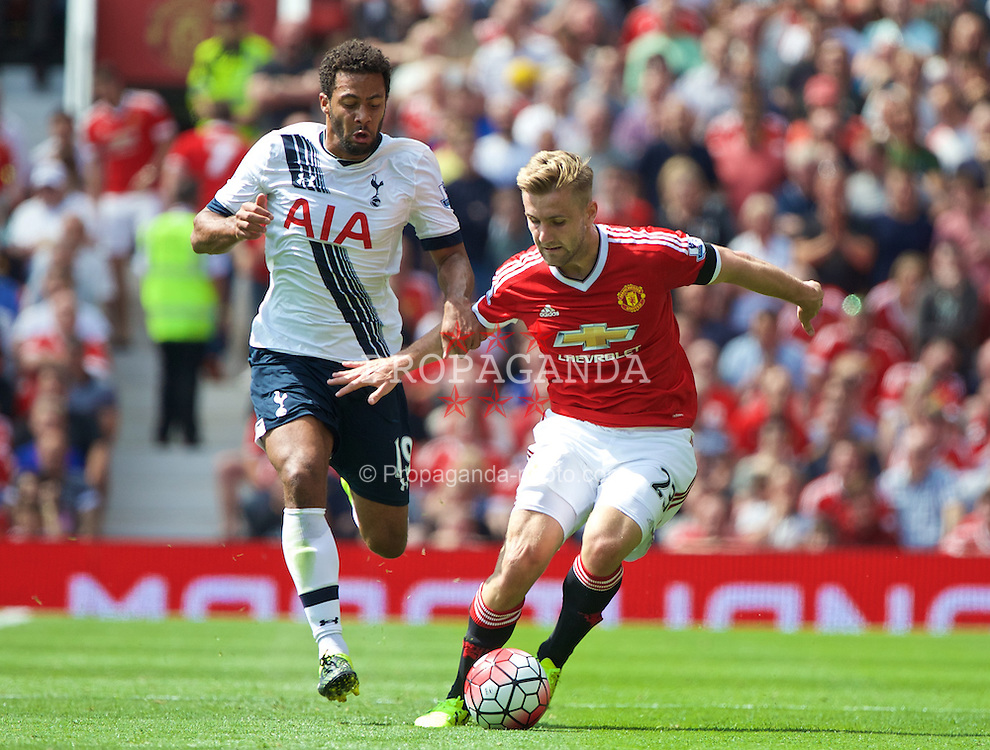 MANCHESTER, ENGLAND - Saturday, August 8, 2015: Manchester United's Luke Shaw in action against Tottenham Hotspur's Mossa Dembele during the Premier League match at Old Trafford. (Pic by David Rawcliffe/Propaganda)