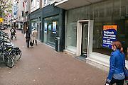 Nederland, Nijmegen, 11-11-2013In de binnenstad van Nijmegen komen steeds meer winkels leeg en te huur te staan. Winkeliers in de binnenstad, binnensteden, hebben naast de crisis ook veel last van verkoop van producten via internet.Foto: Flip Franssen/Hollandse Hoogte
