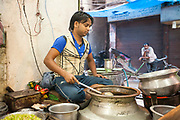 A man serving Nihari (a meat stew) at the Ghaffar nihari wallah, Old Delhi