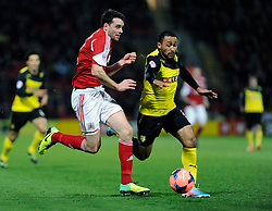 Watford's Ikechi Anya and Bristol City's Brendan Moloney give chase to a loose ball - Photo mandatory by-line: Dougie Allward/JMP - Tel: Mobile: 07966 386802 14/01/2014 - SPORT - FOOTBALL - Vicarage Road - Watford - Watford v Bristol City - FA Cup - Third Round - replay