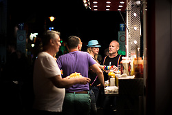 © Licensed to London News Pictures . 26/08/2016 . Manchester , UK . Revellers enjoy a late night on Canal Street in Manchcester's Gay Village for 2016 Manchester Gay Pride Big Weekend . Photo credit : Joel Goodman/LNP