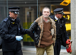 **UNPIXELATED VERION AVAILABLE ON REQUEST**<br /> © Licensed to London News Pictures. 08/04/2018. London, UK. A man being arrested by police after being found carrying what appears to be a weapon at an anti-semitism demonstration outside the headquarters of the Labour Party, in London. Labour party leader Jeremy Corbyn recently apologised for what he described as 'pockets' of anti-Semitism within Labour Party. Photo credit: Ben Cawthra/LNP