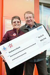 NOT FOR PUBLICATION..Lotto £100,000 winner Barbara outside the Sainsbury Store on  Archer Road Sheffield  where she bought her winning Lotto ticket and where she works.30 November 2011  Image © Paul David Drabble