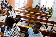 Patients wait at the NDA health center in Dimbokro, Cote d'Ivoire on Friday June 19, 2009.