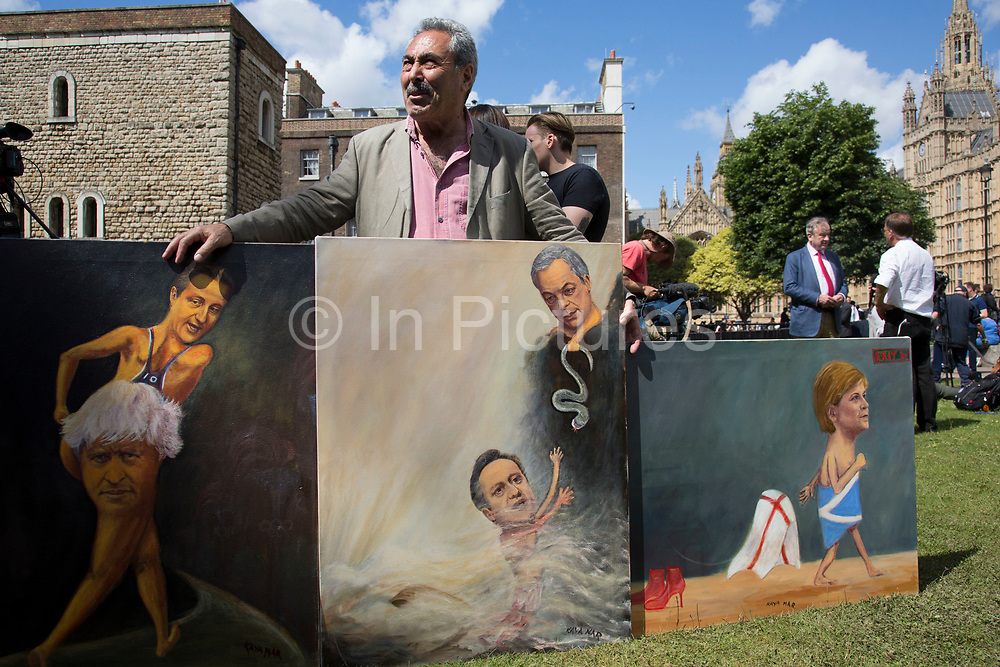 Political artist Kaya Mar with his latest paintings at College Green in Westminster outside the Houses of Parliamant following a Leave vote, also known as Brexit as the EU Referendum in the UK votes to leave the European Union on June 24th 2016 in London, United Kingdom. Membership of the European Union has been a topic of debate in the UK since the country joined the EEC, or Common Market in 1973. It will be the second time the British electorate has been asked to vote on the issue of Britains membership: the first referendum being held in 1975, when continued membership was approved by 67% of voters. The two sides are the  Leave Campaign, commonly referred to as a Brexit, and those of the Remain Campaign who are also known as the In Campaign.