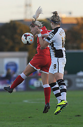 Bristol Academy Womens' Nicola Watts challenges for the ball in mid-air. - Photo mandatory by-line: Nizaam Jones - Mobile: 07583 387221 - 04/10/2014 - SPORT - Football - Bristol - Stoke Gifford Stadium - BAWFC v Notts County Ladies - Sport