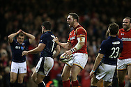 George North of Wales celebrates after he scores his teams 3rd try. RBS Six nations championship 2016, Wales v Scotland at the Principality Stadium in Cardiff, South Wales on Saturday 13th February 2016. <br /> pic by  Andrew Orchard, Andrew Orchard sports photography.