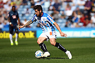 Jacob Butterfield of Huddersfield Town in action. Skybet football league championship match, Huddersfield Town v Derby county at the John Smith's stadium in Huddersfield, Yorkshire on Saturday 18th April 2015.<br /> pic by Chris Stading, Andrew Orchard sports photography.