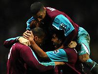 Photo: Paul Greenwood.<br />Blackburn Rovers v West Ham United. The Barclays Premiership. 17/03/2007.<br />Hatden Mullins (top) jumps onto Carlos Tevez and Bobby Zamora in celebration