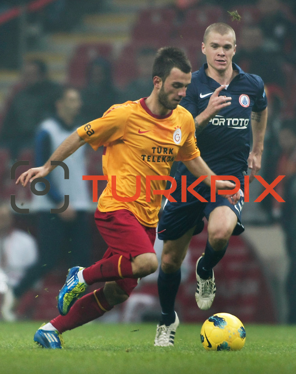 Galatasaray's Emre Colak (L) and IBBSpor's Samuel Holmen (R) during their Turkish Super League soccer match Galatasaray between IBBSpor at the TT Arena at Seyrantepe in Istanbul Turkey on Tuesday, 03 January 2012. Photo by TURKPIX