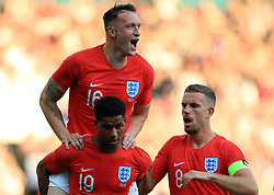 England's Marcus Rashford (bottom left) celebrates scoring his side's first goal of the game with team mate Phil Jones and Jordan Henderson (right) during the International Friendly match at Elland Road, Leeds.