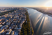 Aerial view of the Upper West Side of New York City and the Hudson River, photographed at sunset from a helicopter.