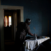 Yvonne Wilson gathers her things before leaving her sister's home in the Baptist Town neighborhood of Greenwood, Mississippi on November 30, 2011.