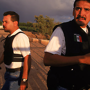 Mexico's Federal Police force Grupo Beta, whose job it is to protect migrants, search for a suspect who had just robbed a migrant along the U.S./Mexico border in Agua Prieta across from Nogales, Arizona. Please contact Todd Bigelow directly with your licensing requests.