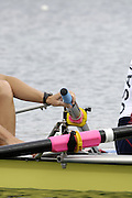 Munich, GERMANY, 2006,USA W2- Bow Megan Cooke and Anna Mickelson, Mickelsen stretches, FISA, Rowing, World Cup,  on the Olympic Regatta Course, Munich, Fri. 26.05.2006. © Peter Spurrier/Intersport-images.com,  / Mobile +44 [0] 7973 819 551 / email images@intersport-images.com.[Mandatory Credit, Peter Spurier/ Intersport Images] Rowing Course, Olympic Regatta Rowing Course, Munich, GERMANY