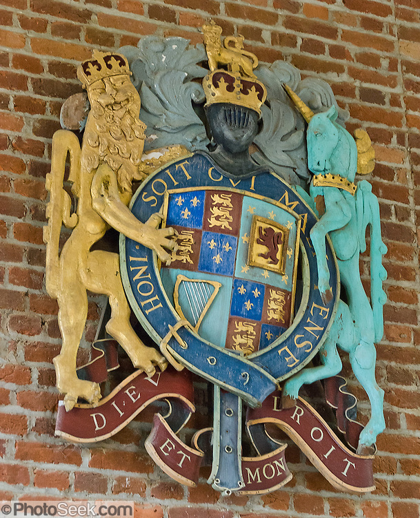 """On the wall of Memorial Church on Jamestown Island, Virginia, is the official Coat of Arms of the United Kingdom and Ireland, used 1603-1649 by James VI (King of Scots), 1660-1689 by Charles II, and 1702-1707 by Queen Anne: The coat features both the motto of the English monarchy, """"Dieu at mon droit"""" (""""God and my right""""), and also the motto of the order of the Garter (Knighthood), """"Honi soit qui mal y pense"""" (""""Shamed be he who thinks evil of it""""). James VI, King of Scots inherited the English and Irish thrones in 1603 (Union of the Crowns), and quartered the Royal Arms of England with those of Scotland. For the first time, the Royal Coat of Arms of Ireland (the harp) was added to represent the Kingdom of Ireland. Jamestown, located on Jamestown Island in the Virginia Colony, was founded on May 14, 1607. It is the first permanent English settlement in what is now the United States of America, following several earlier failed attempts. The Virginia Company of London founded Jamestown in 1607."""