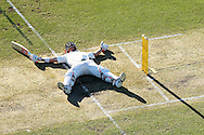 PERTH, AUSTRALIA - NOVEMBER 03: David Warner of Australia lies on the pitch after slipping while playing a shot during day one of the First Test match between Australia and South Africa at the WACA on November 3, 2016 in Perth, Australia.  (Photo by Paul Kane/Getty Images)