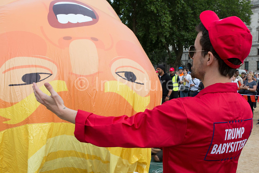 The inflatable balloon called Baby Trump is almost readt to fly above Parliament Square in Westminster, the seat of the UK Parliament, during the US Presidents visit to the UK, on 13th July 2018, in London, England. Baby Trump is a 20ft high orange blimp depicting the US President as an enraged, smartphone-clutching infant - and given special permission to appear above the capital by London Mayor Sadiq Khan because of its protest rather than artistic nature. It is the brainchild of Graphic designer Matt Bonner.