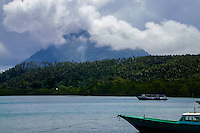 Indonesia, Sulawesi, Bunaken. Manado Tua wrapped in clouds.