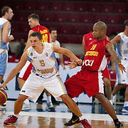 Ukraine's Denys LUKASHOV (L) and Montenegro's Omar COOK (R) during their Istanbul CUP 2011match played Ukraine between Montenegro at Abdi Ipekci Arena in Istanbul, Turkey on 24 August 2011. Photo by TURKPIX