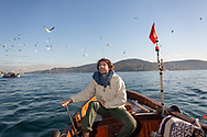 Celebrite chef Mehmet Gürs on a small fishing boat on the Bosphorus in Istanbul, where he said he would eat his last meal, fresh oysters and a bottle of wine. Mehmet often goes fishing in the Bosphorus, alone and with local fishermen.