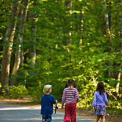 Kids walk with their fishing poles in Greenfield State Park in Greenfield, New Hampshire.