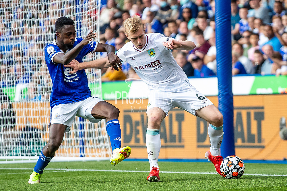 Burnley central defender Ben Mee battles for possession during the Premier League match between Leicester City and Burnley at the King Power Stadium, Leicester, England on 25 September 2021.