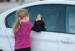 Ella-Grace Trudeau plays at the window of a car with her brother Hadrien as she waits for her father Canadian Prime Minister Justin Trudeau and mother Sophie Gregoire-Trudeau to get out at the airport Saturday, November 28, 2015 in Valletta, Malta. Trudeau is heading to Paris for the United Nations climate change summit. Photo by Adrian Wyld/CP/ABACAPRESS.COM  | 525895_001 Valletta Malte Malta
