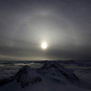 A halo, an optical phenomena from sunlight and ice crystals, rises above Goldberg group mountains, seen from Sonnblick summit at 3,106 meters above sea level, in the Hohe Tauern mountain range near Rauris, Austria, November 23, 2018. REUTERS/Lisi Niesner