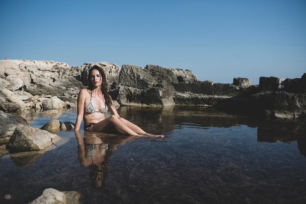 Marylin, visiting Ibiza from Belgium, beside the sea near Salinas Beach. (August 2018)