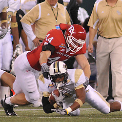 Dec 19, 2009; St. Petersburg, Fla., USA; Rutgers linebacker Ryan D'Imperio (44) tackles UCF wide receiver Jamar Newsome (9) during NCAA Football action in Rutgers' 45-24 victory over Central Florida in the St. Petersburg Bowl at Tropicana Field.