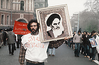 Scenes in London near the Iranian Embassy during the siege of the embassy in May 1980. Protestors carry picture of the Supreme leader of Iran Ayatollah Khomeini. Photograph by Jayne Fincher