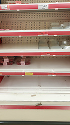 "© Licensed to London News Pictures. 22/12/2020. London, UK. Empty shelves of meat items in Sainsbury's supermarket in north London as people buy festive groceries and food items, just three days before Christmas day. A number of supermarkets have warned that some items may run low this week. Prime Minister Boris Johnson urged in a press conference for people to ""shop normally"". It came after France closed the borders - banning UK travellers to their country, to stop the spread of the new variant of Covid-19. Photo credit: Dinendra Haria/LNP"