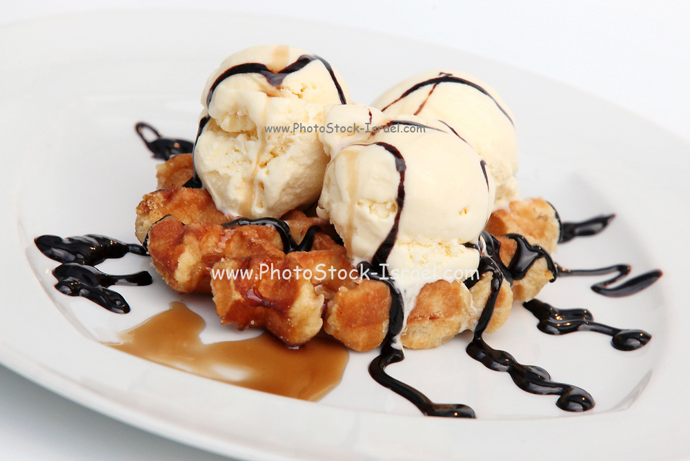 Waffle with icecream chocolate and maple syrup