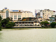 31 MARCH 2012 - HANOI, VIETNAM: The skyline of the Old Quarter of Hanoi, Vietnam with Lake Ho Hoan Kiem in the foreground.    PHOTO BY JACK KURTZ