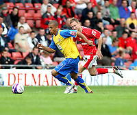 Photo: Mark Stephenson.<br /> Wrexham v Hereford United. Coca Cola League 2. 01/09/2007.Hereford's Lionel Ainsworth gets away from Rexham's Michael Proctor