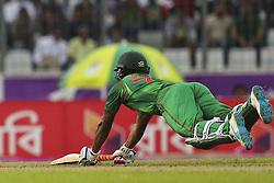 October 9, 2016 - Dhaka, Bangladesh - Bangladesh's Sakib Al Hasan dives to reach the line during the second one day international cricket match against England in Dhaka, Bangladesh, Friday, Oct. 9, 2016. (Credit Image: © Ahmed Salahuddin/NurPhoto via ZUMA Press)