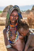 Arbore tribe woman breastfeeding her child, Omo Valley, Ethiopia.