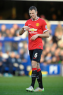 Jonny Evans of Manchester United looks on. Barclays Premier league match, Queens Park Rangers v Manchester Utd at Loftus Road in London on Saturday 17th Jan 2015. pic by John Patrick Fletcher, Andrew Orchard sports photography.