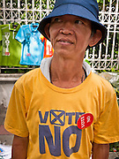 "22 JUNE 2011 - BANGKOK, THAILAND: A Thai Yellow Shirt at a PAD vote ""no"" rally in Bangkok on Wednesday, June 22. The PAD (People's Alliance for Democracy) or Yellow Shirts, as they are popularly called, has called for a ""No"" vote in Thailand's national election, scheduled for July 3. PAD leadership hopes the no vote will negate the vote of Yingluck Shinawatra, leader of the Pheua Thai party. Yingluck is the youngest sister of exiled former Prime Minister Thaksin Shinawatra, deposed by a military coup in 2006. Yingluck is currently leading in opinion polls, running well ahead of incumbent Prime Minister Abhisit Vejjajiva, head of the Democrat party, which in one form or another has ruled Thailand for most of the last 60 years.     Photo by Jack Kurtz"