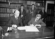 Dissolution of  22nd Dáil Éireann 1982. .27/01/1982.01/27/82.27th January 1982.Photograph of the Taoiseach, Garret Fitzgerald, signing the warrant of dissolution of the Dáil. The signing was carried out at  Áras an Uachtaráin.
